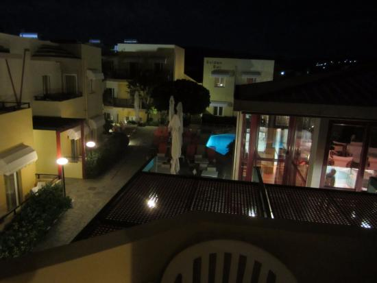 Golden Bay Hotel: Night view from back deck into central open area
