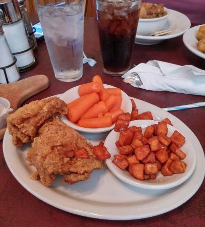 Yoder, KS: Chicken dinner with glazed carrots sweet potatoes