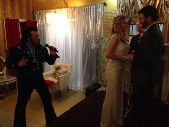 Rhinestone Wedding Chapel Elvis Serenading While Presenting Bride
