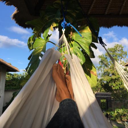 Relaxing by the beautiful pool at Padang Padang Surf Camp.