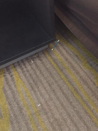 Comfort Suites Miami Airport North: Toe nail clippings and qtip on floor upon arrival.