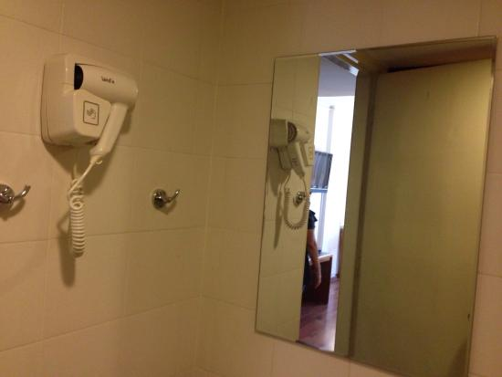Mirama Hotel: Toilet with hanging blower. Great!