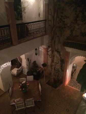 Riad Tawargit: View of eating area and fireplace from the 1st floor balcony