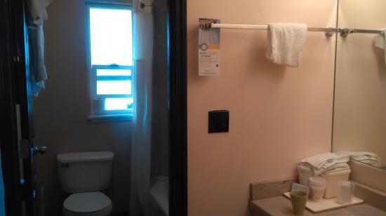 Quality Inn & Suites: split bathroom, with granite counter sink