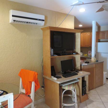 Sunrise Beach Clubs and Villas: living room tv desktop computer