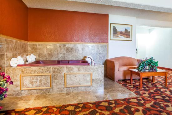 Jacuzzi Whirlpool Hot Tub in GuestRoom Suite at Quality Inn & Suites Independence Missouri