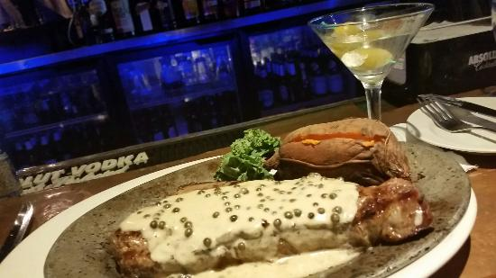 Tropical Acres Restaurant: Come sit at the bar and have a big juicy steak. Let Tom the bar tender recomend something. You w