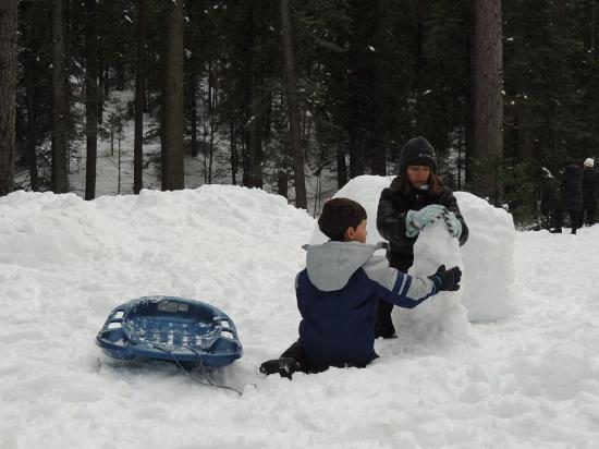 Family fun and snowman making at Tamarack Lodge at Bear Valley