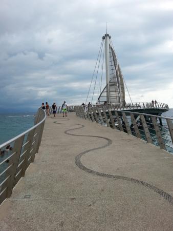 Los Muertos Pier: Walking up the pier.