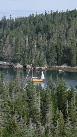Southwest Harbor, ME: Looking down at Premise anchored in Duck Harbor on Isle Au Haut from Duck Harbor Mountain -- a g