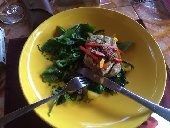 Grilled Tuna Steak with basil and peppers on a bed of potatoes topped ...