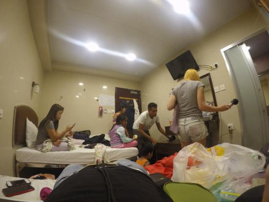 Hong Kong Tai Wan Hotel: Thanks to Gopro the room appears larger. 7 heads sharing one very small room when we booked for