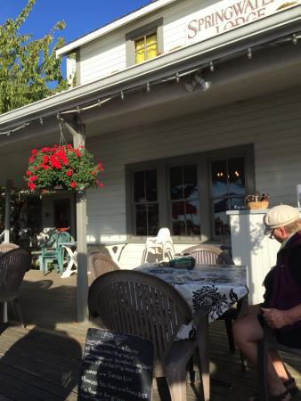 Mayne Island, Kanada: Experior view of the patio, enjoying the summer sunshine! Springwater Lodge  |  400 Fernhill Rd,