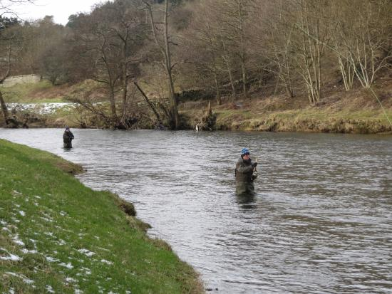Selkirk, UK: Father and Son on the River Tweed with 'Tweed Guides'.