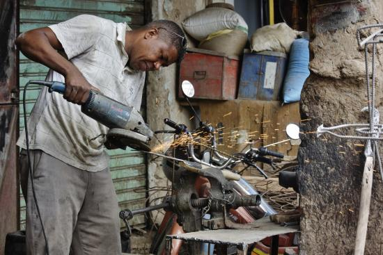 Wheels Across Morocco - Day Tours: Angle grinder in the market