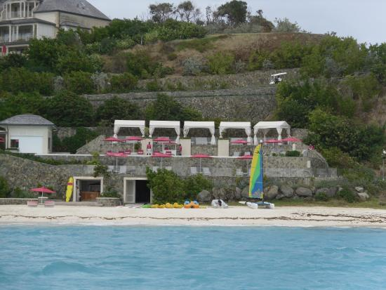 Canouan Resort at Carenage Bay - The Grenadines: view from water of pool and beach at Pink Sand