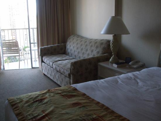 OHANA Waikiki East Hotel: King bed and couch.