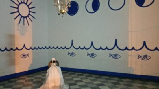 Main room with doll on a chair - Picture of Santeria Israel