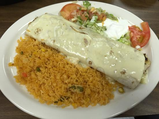 Hiawatha, KS: Seafood enchilada with queso on top (all rice & no beans as sides)