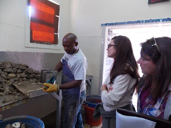 Tilghman, MD: People observing an oyster shucker