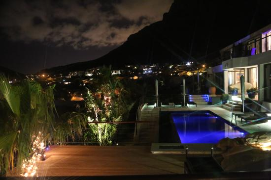 Atlanticview Cape Town Boutique Hotel: Romantic Lighting enhance the main villa decks with views of the Mountains that disappear into t