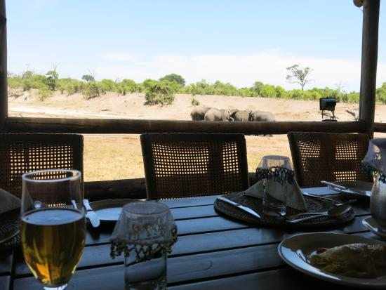 Savute Safari Lodge: Dining area with view of water hole