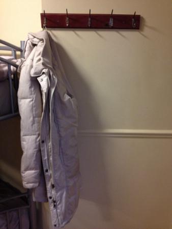Castle Hostel: Coat racks in each room.