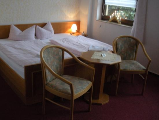 """Berghotel Steiger: twin beds in room  15... check out the handmade """" Schwibbogen"""" with the Christmas lights on the"""