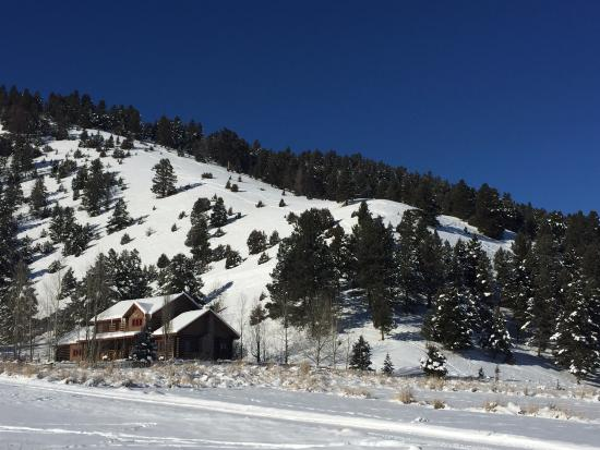 The Ranch at Rock Creek: View of Bear House guest cabin & hill you can ski