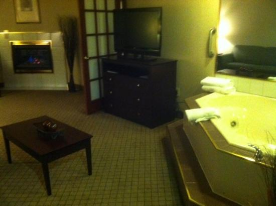 "Rothschild, WI: The ""living room"" portion of the suite features a hot tub and a gas fireplace."