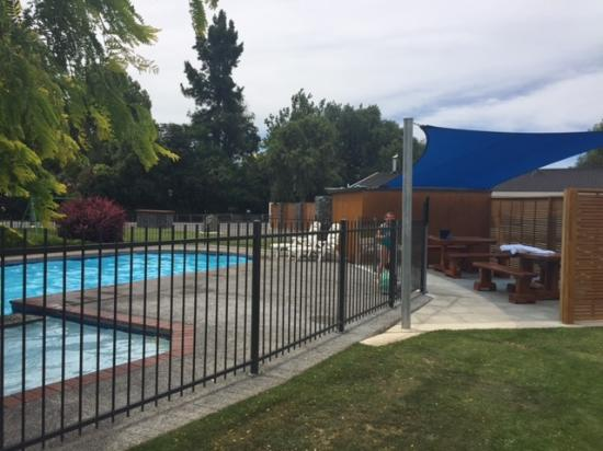 Cherylea Motel: View of pool and outdoor eating area. Trampoline in background.