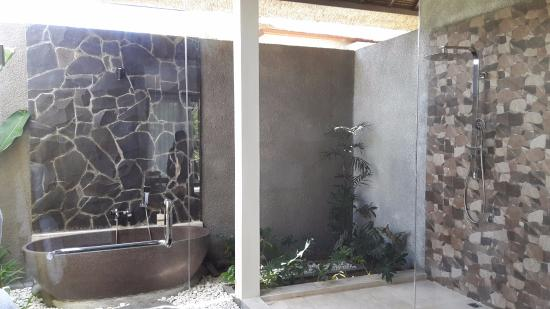 anusara luxury villas master bedroom outside bathroom with stone tub and rain shower - Luxury Stone Showers