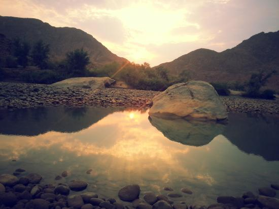 Camp Syncro: sunrise over the Kunene at Camp Syncro