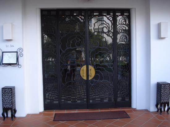 Spa entrance via ornate iron doors picture of la residence hue la residence hue hotel spa spa entrance via ornate iron doors planetlyrics Image collections