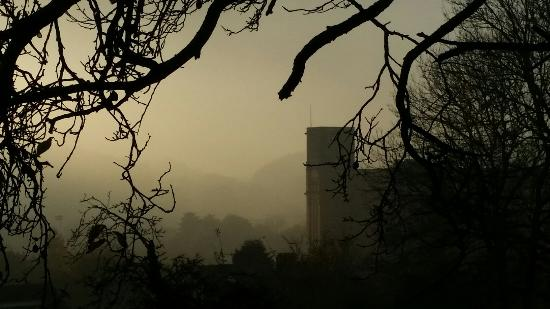 Strutt's North Mill: A foggy day, with the sun setting over the Chevin