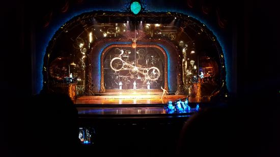 Two Men Running Around This Moving Double Ring Picture Of Zarkana