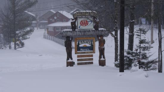 Inlet, NY: There sign with hand carved vertical posts, totume pole style gave it that Adirondack feel