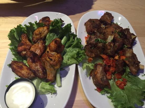 Portage la Prairie, Canadá: Baked wings and salt a pepper ribs, Boston Pizza  |  2180 Saskatchewan Avenue W, Portage la Prai