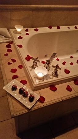 The Delafield Hotel: rose petals and chocolates put in room while they were out