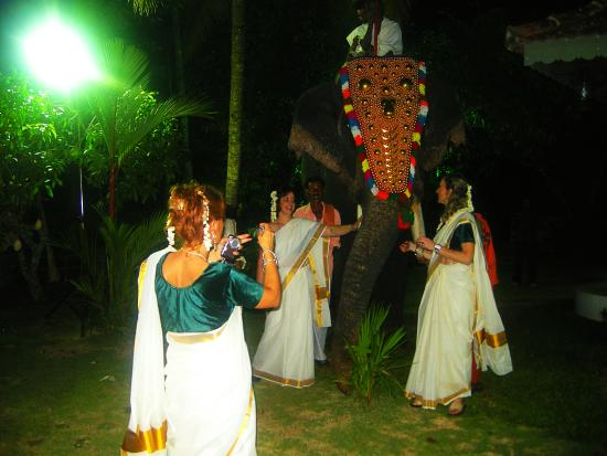 Kovilakam Lakeside Villa: Memories to take home. Our guests clad in traditional attire striking a pose with an elephant cl