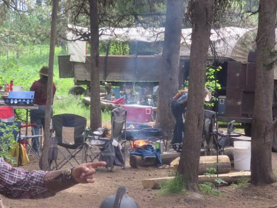 Teton Wagon Train & Horse Adventure : Starting dinner, everything cooked over an open fire.