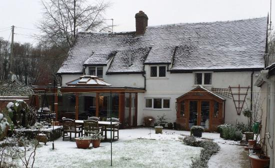 Eccleshall, UK: View from the garden after a light snow fall