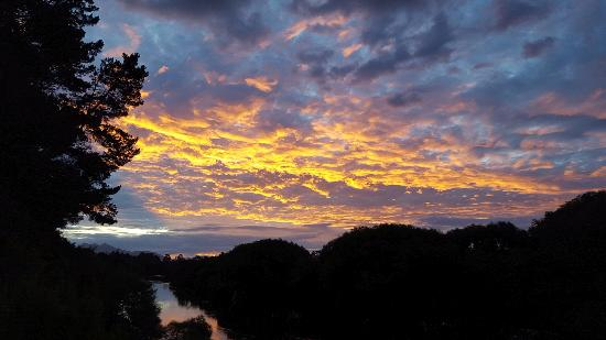 Sunset over Waikato river at Aultmore Hollow River cottage