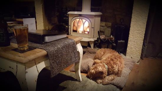 Warkworth, UK: Biscuit and boots drying by the fire