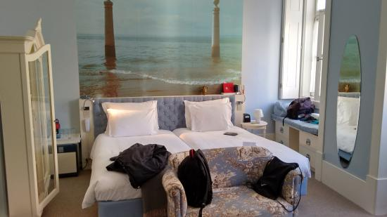LX Boutique Hotel: Lovely bedroom with headboard photo of local waterfront