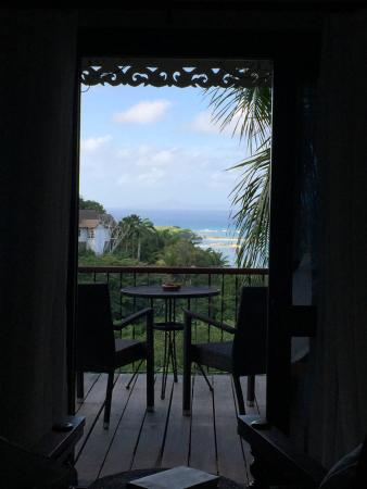 Mustique: Morning vision through the bedroom doors.