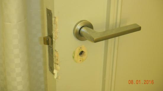 The Westin New Orleans Canal Place: Bathroom door that had been damaged and badly repaired
