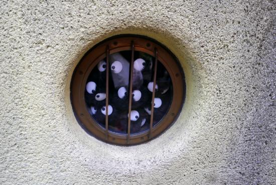 Ghibli Museum: Detail of the soot spirits in a little window by Totoro Reception