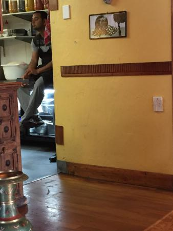 Indian Sumner : Sad to see kitchen staff sitting on a food preparation surface! Pic taken as I was until that po