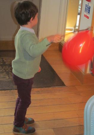 Child Armed With Balloon Picture Of Pizza Express